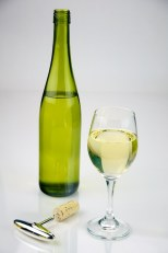 Glass of White Wine shot with a bottle of white wine.