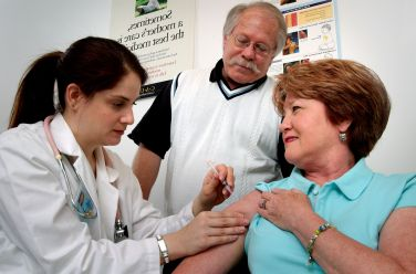 Middle aged woman was receiving an intramuscular vaccination int